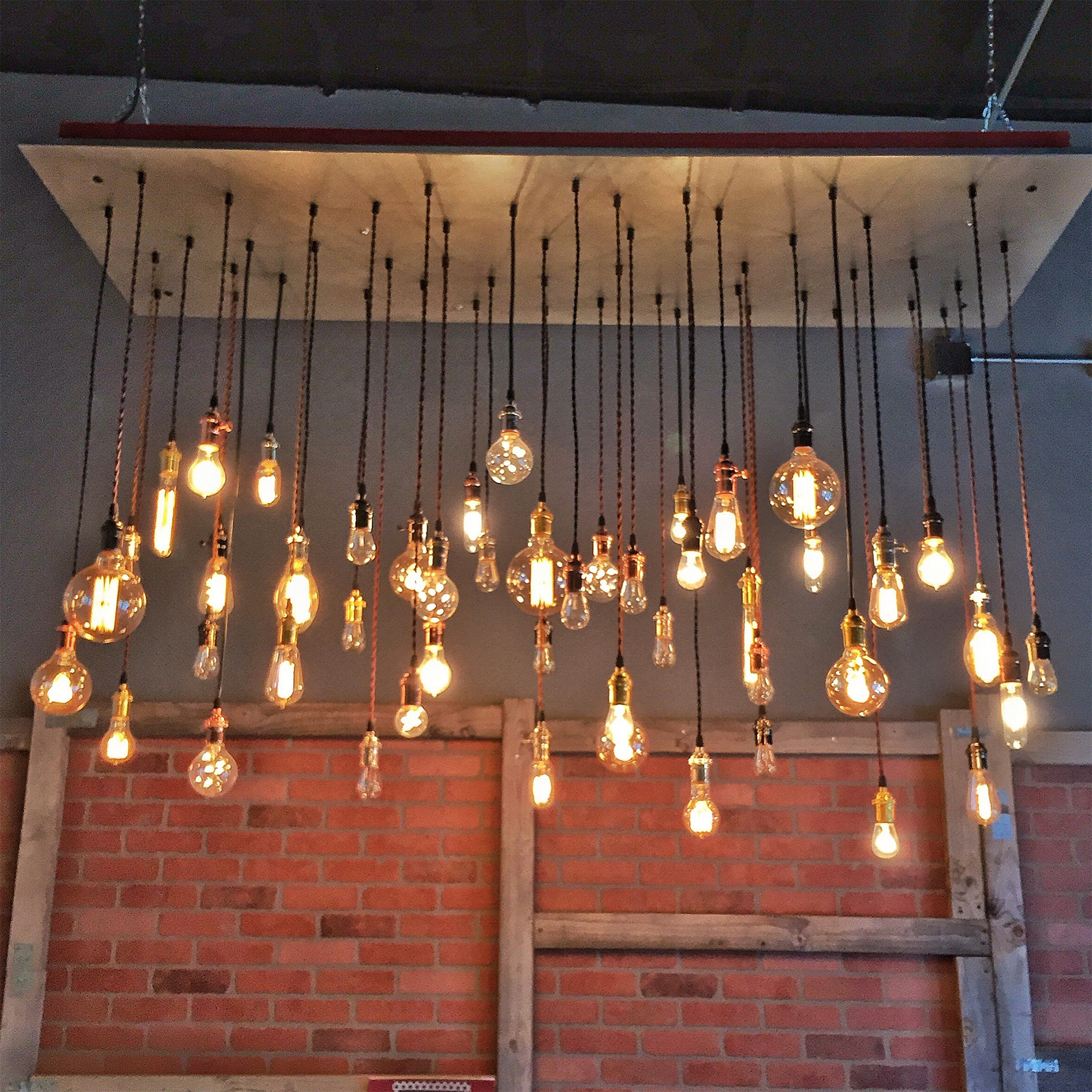 large metal clad pendant chandelier in a office