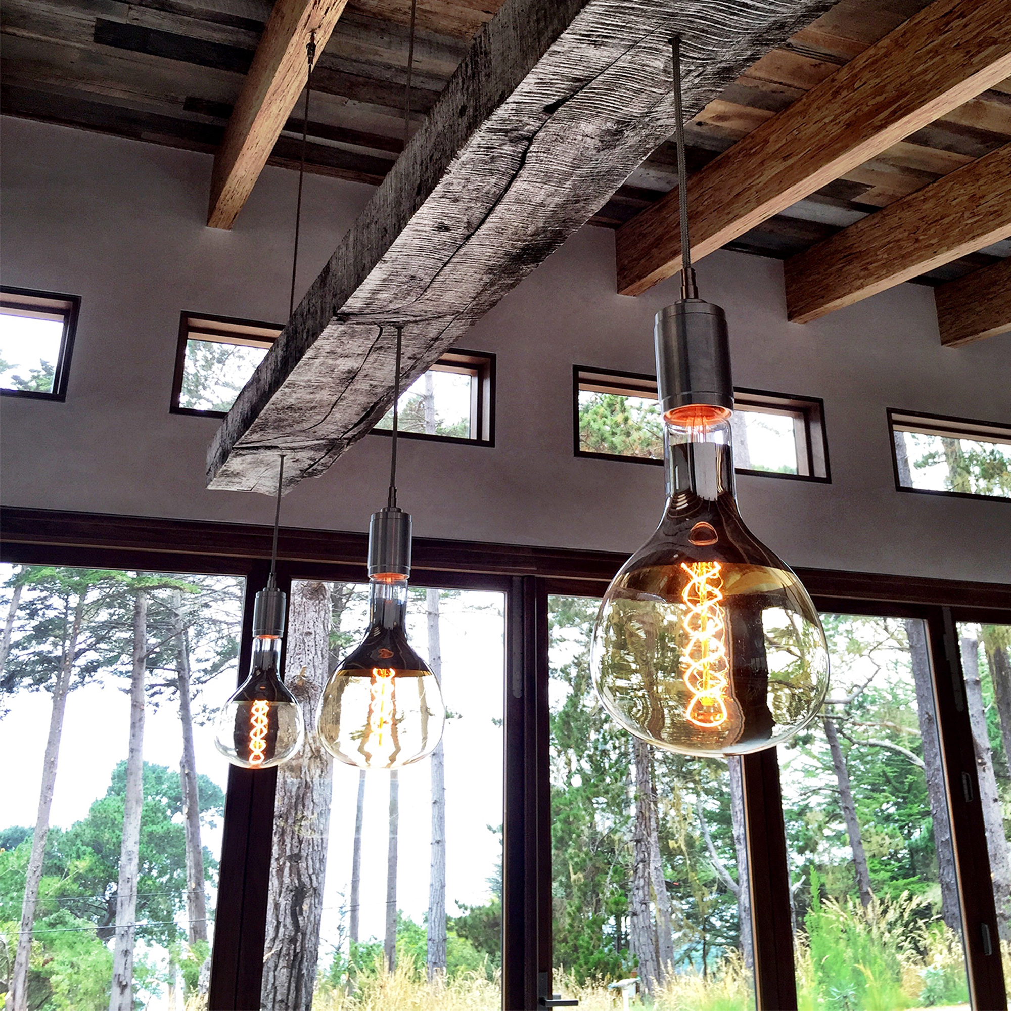 wood beam with custom pendant light