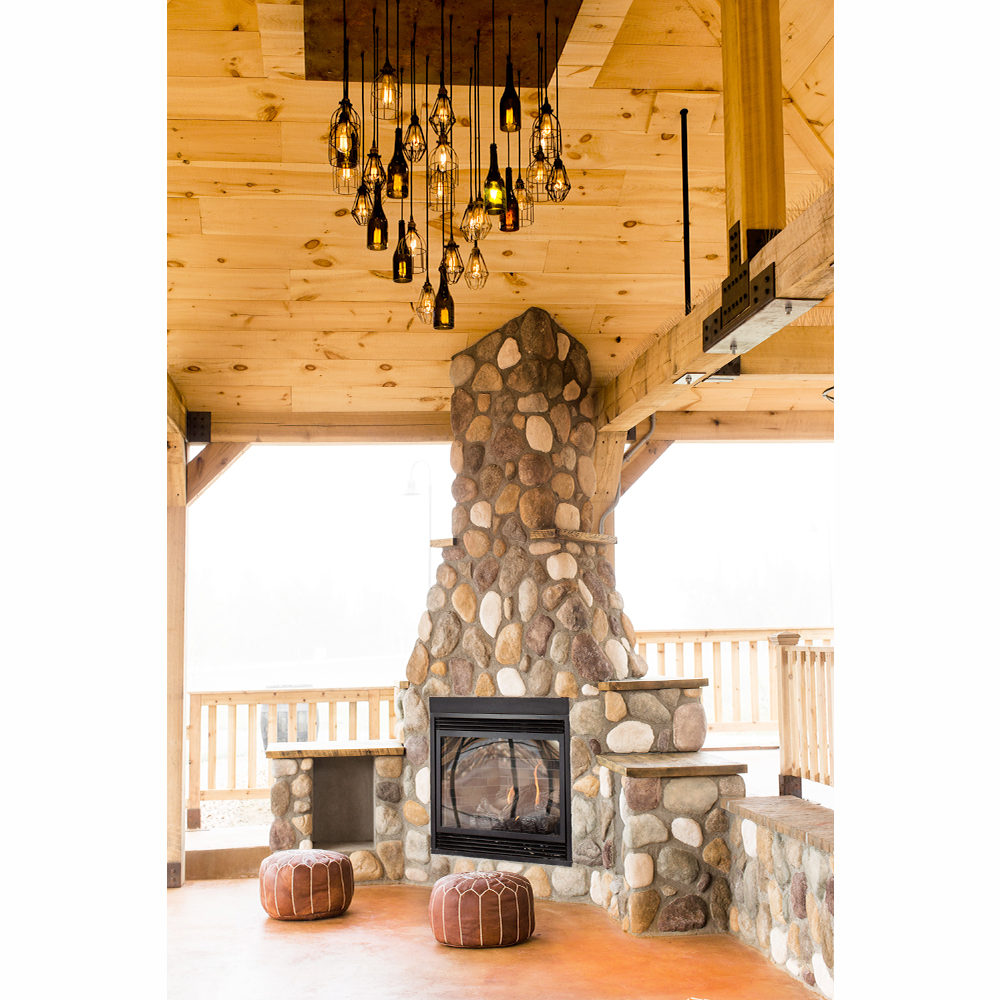 patio pavillion with stone fireplace and wine bottle pendant chandelier