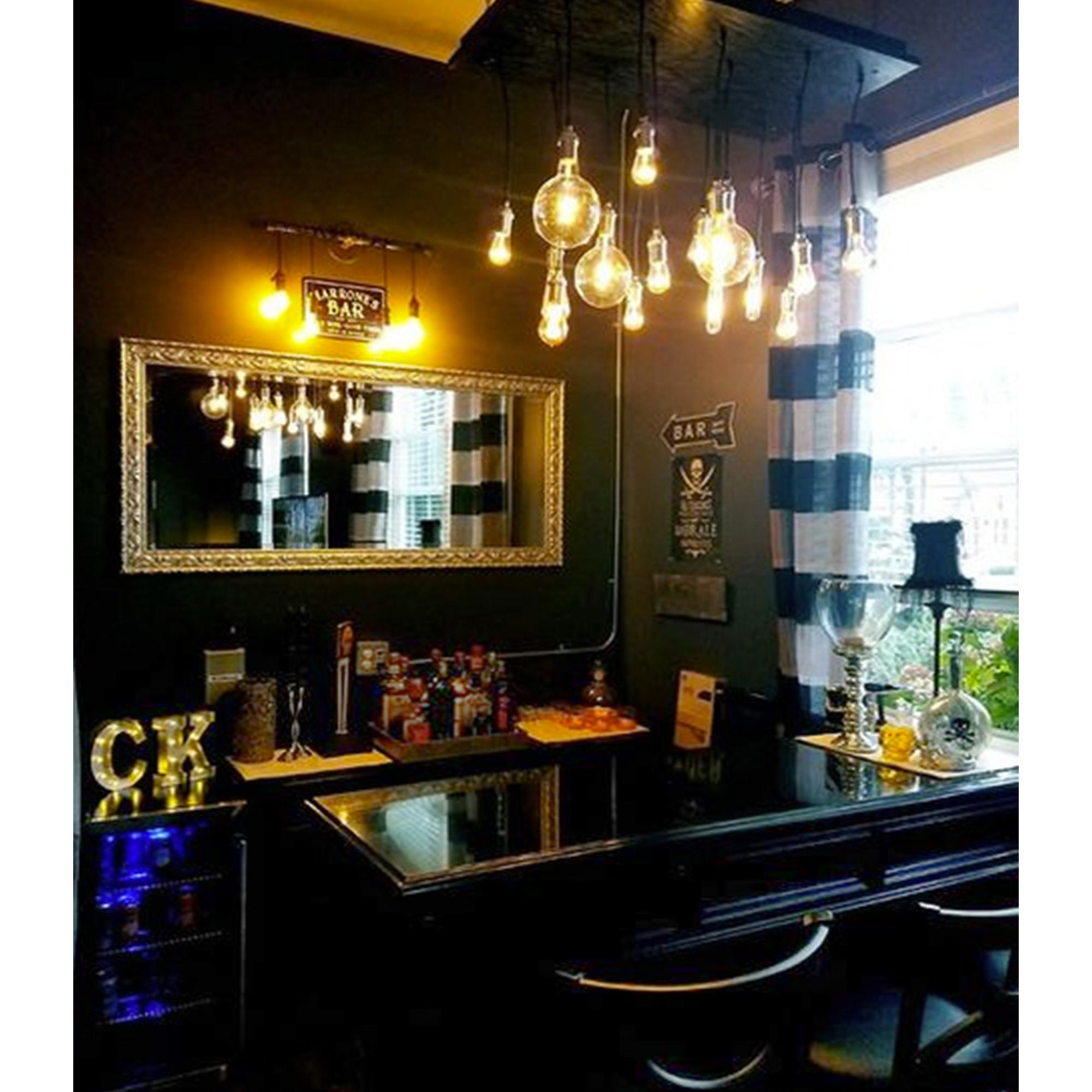 edison bulb chandelier over a bar